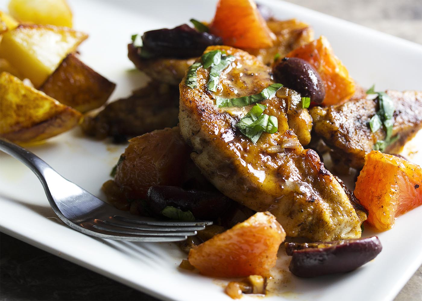 Easy and quick! This Mediterranean chicken skillet combines tender chicken breast with olives and oranges for a spicy/sweet dinner recipe. Great with roasted potatoes or over rice. | justalittlebitofbacon.com