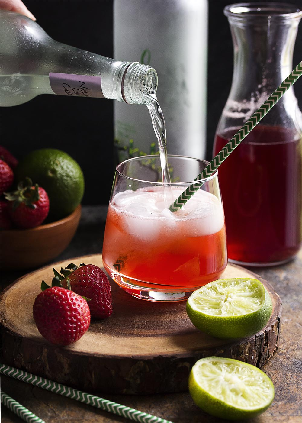 Homemade strawberry syrup topped with ginger beer makes this Brazilian strawberry caipirinha cocktail a refreshingly fruity fizzy drink perfect for summer!   justalittlebitofbacon.com
