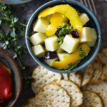 Cubes of Spanish manchego cheese is marinated in a mixture of hot peppers, olive oil, and herbs in this easy manchego tapas recipe. | justalittlebitofbacon.com