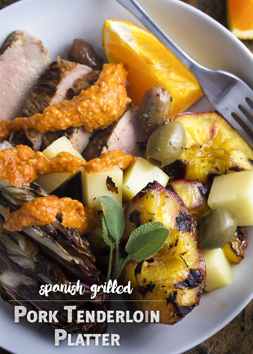 This grilled pork tenderloin peaches and radicchio platter is full of great Spanish flavors and fun additions to make this an excellent meal for a special occasion. Or for next Saturday night! | justalittlebitofbacon.com