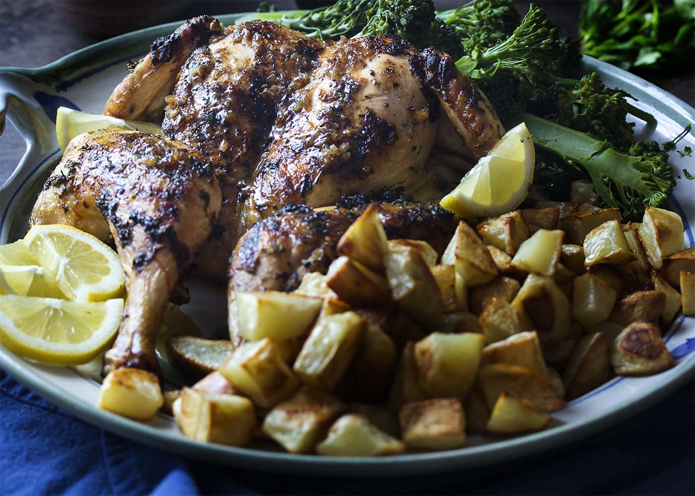 A French herb rub, a sweet and spicy glaze, and a caramelized shallot butter all combine to make a grilled whole chicken full of layered flavors. | justalittlebitofbacon.com