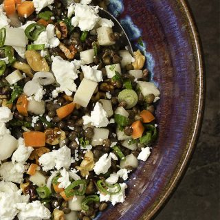 This cold French lentil and kohlrabi salad makes a great summer recipe! The spicy kohlrabi and earthy lentils are tossed with carrots and goat cheese for a tasty weeknight side dish. Healthy, easy, and quick! | justalittlebitofbacon.com