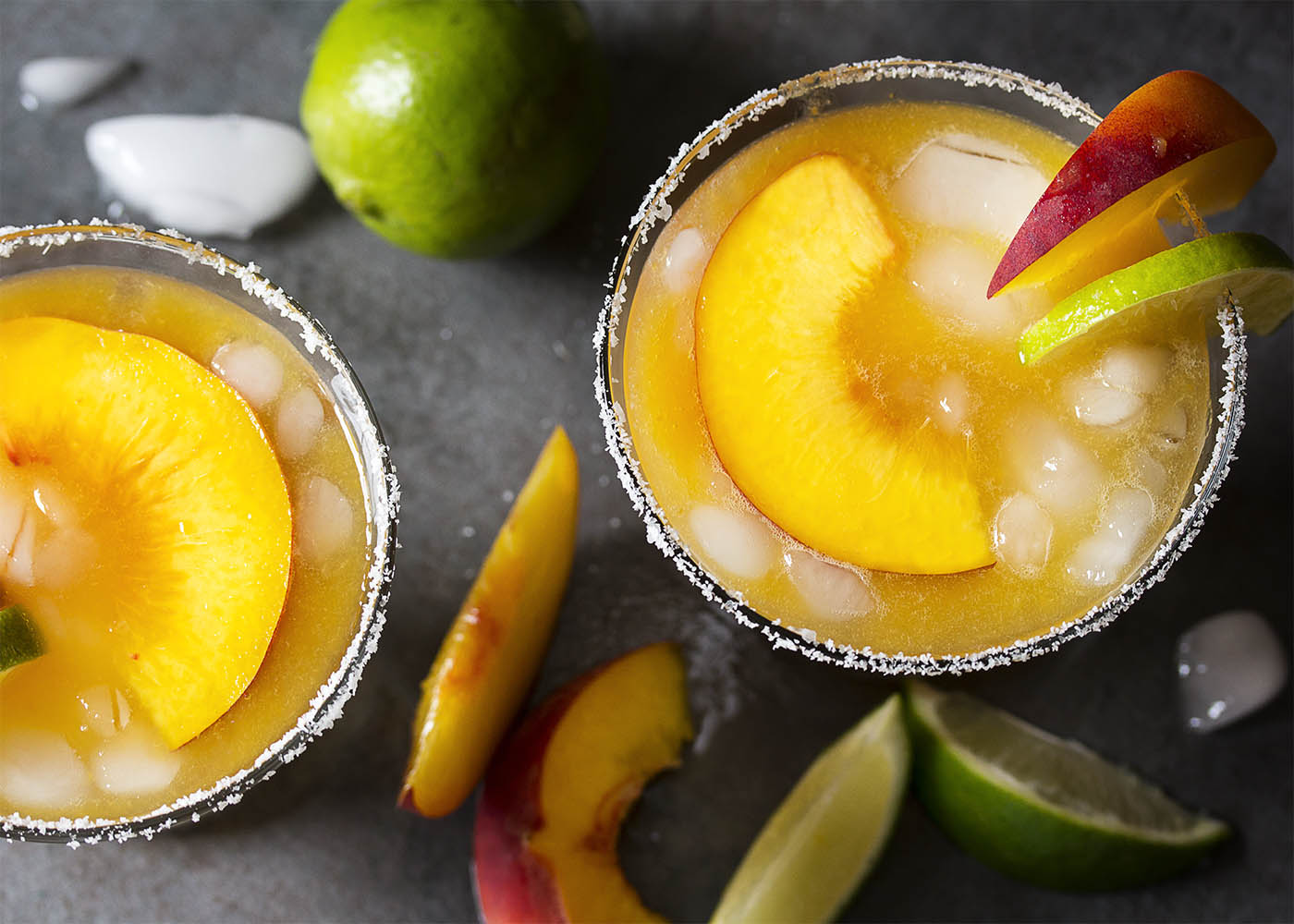 Have some overripe peaches on the counter? Puree them up into an intensely peachy and not too sweet fresh peach margarita on the rocks! | justalittlebitofbacon.com
