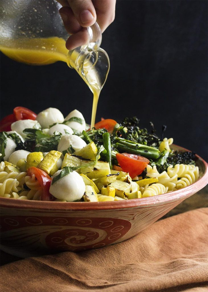 My Italian pasta salad takes advantage of summer by grilling the vegetables and then tossing them with homemade Italian dressing. Light, fresh, and easy! | justalittlebitofbacon.com