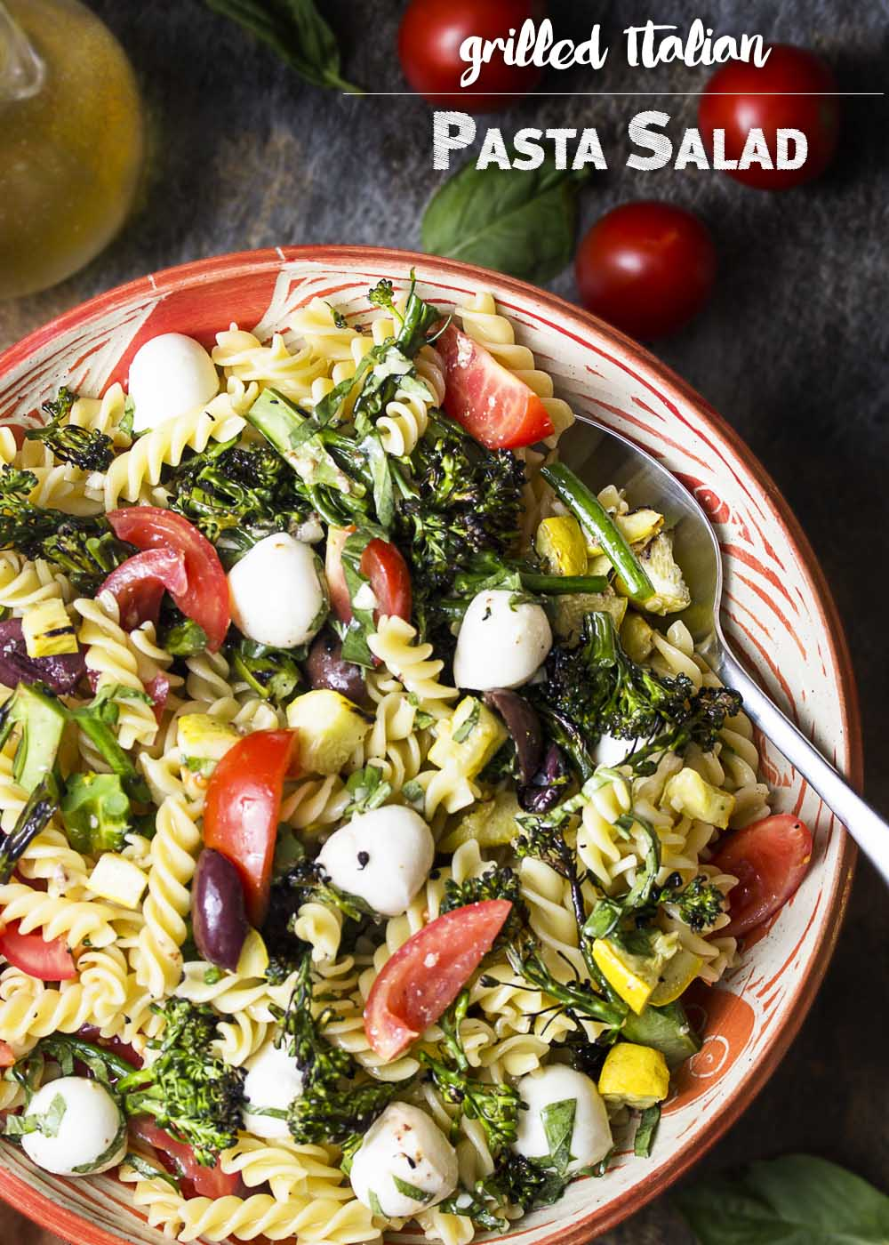 My Italian pasta salad takes advantage of summer by grilling the vegetables and then tossing them with homemade Italian dressing. Light, fresh, and easy!   justalittlebitofbacon.com