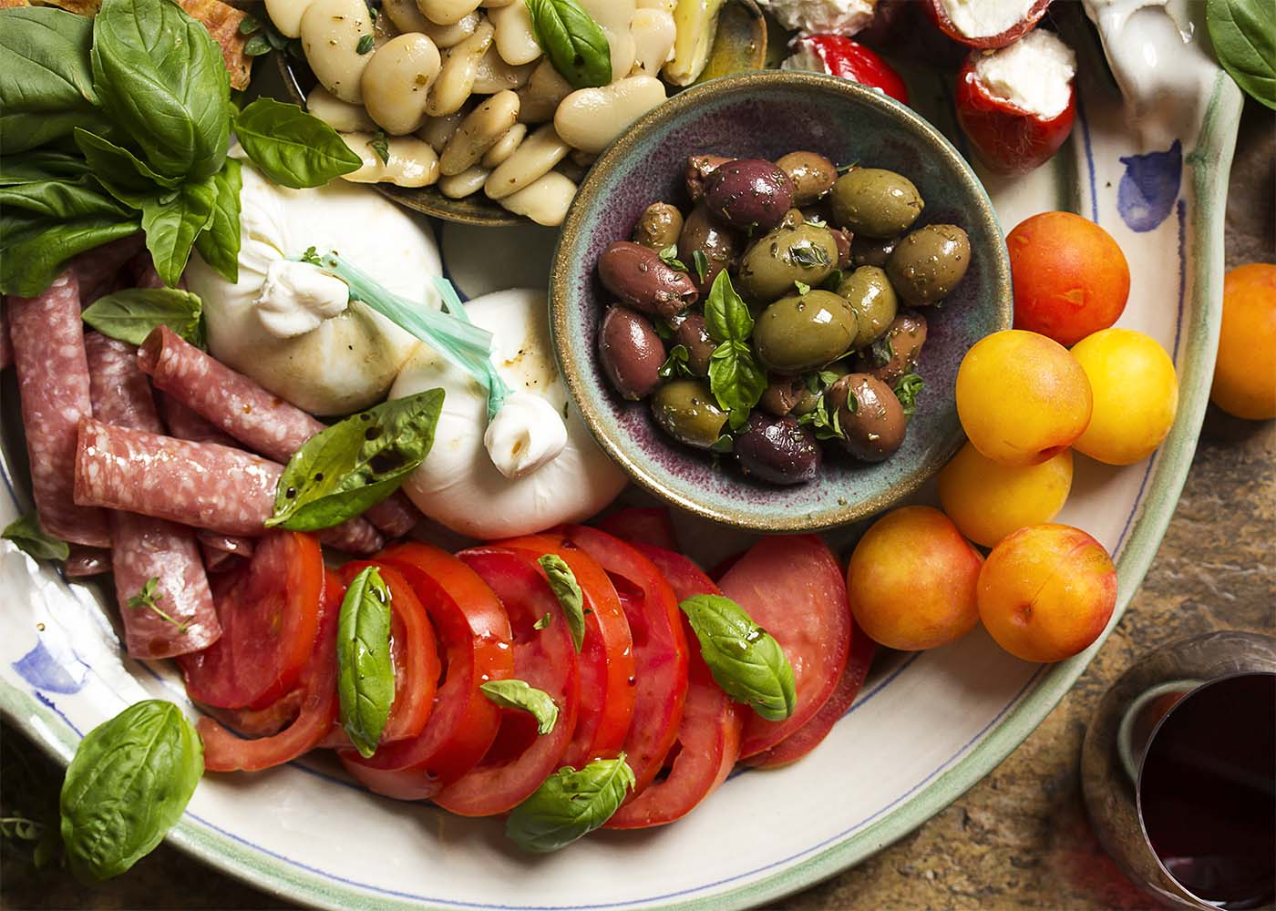 No cooking required! I love this easy Italian cold antipasto platter for summer's evenings when I want something simple for dinner. Great for two and can scale up for a crowd. | justalittlebitofbacon.com