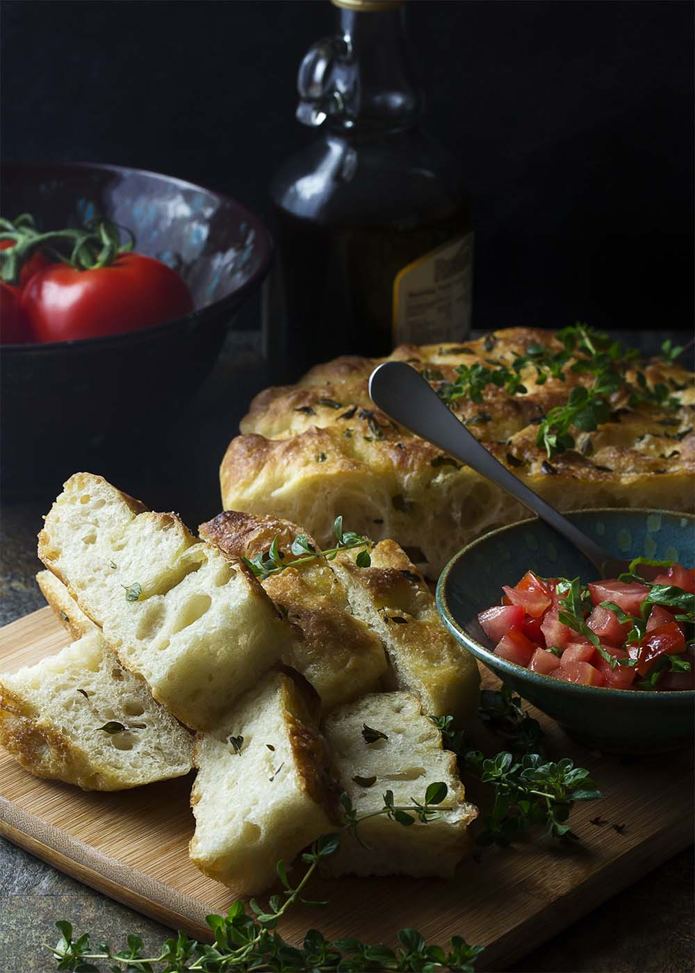 My no-knead focaccia bread with garlic and thyme is made right in a cast iron skillet, giving it a soft and chewy interior and crispy edges. Easy! Great for dinner or for paninis!   justalittlebitofbacon.com
