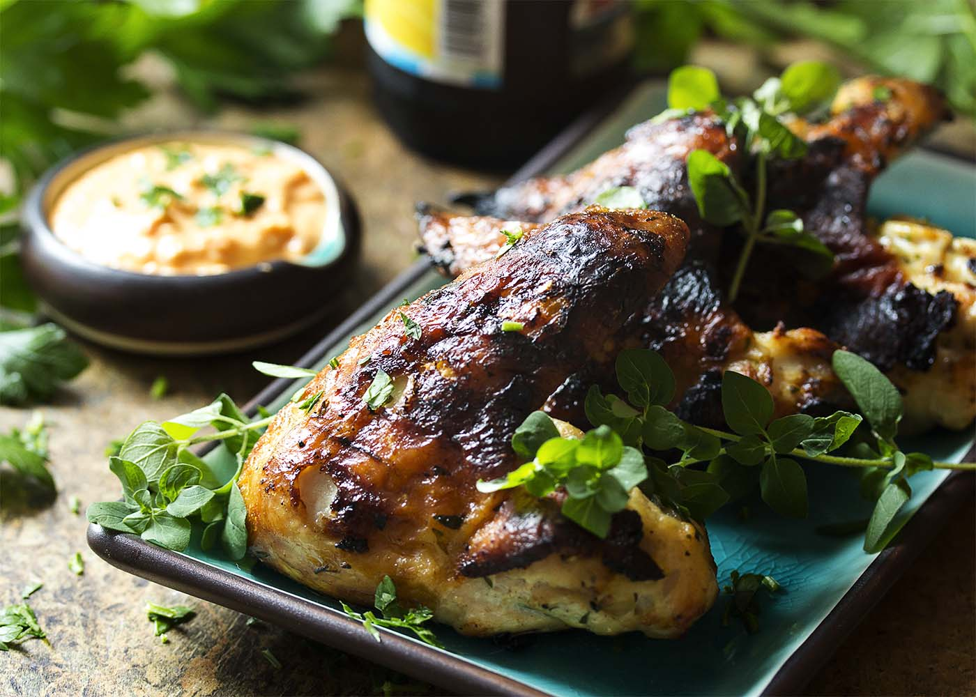 Yogurt marinated chicken wings are so flavorful, tender and juicy which makes these grilled Greek wings a fun and easy party food! Great by themselves or with a dipping sauce, like roasted pepper feta dip or tzatziki sauce.   justalittlebitofbacon.com