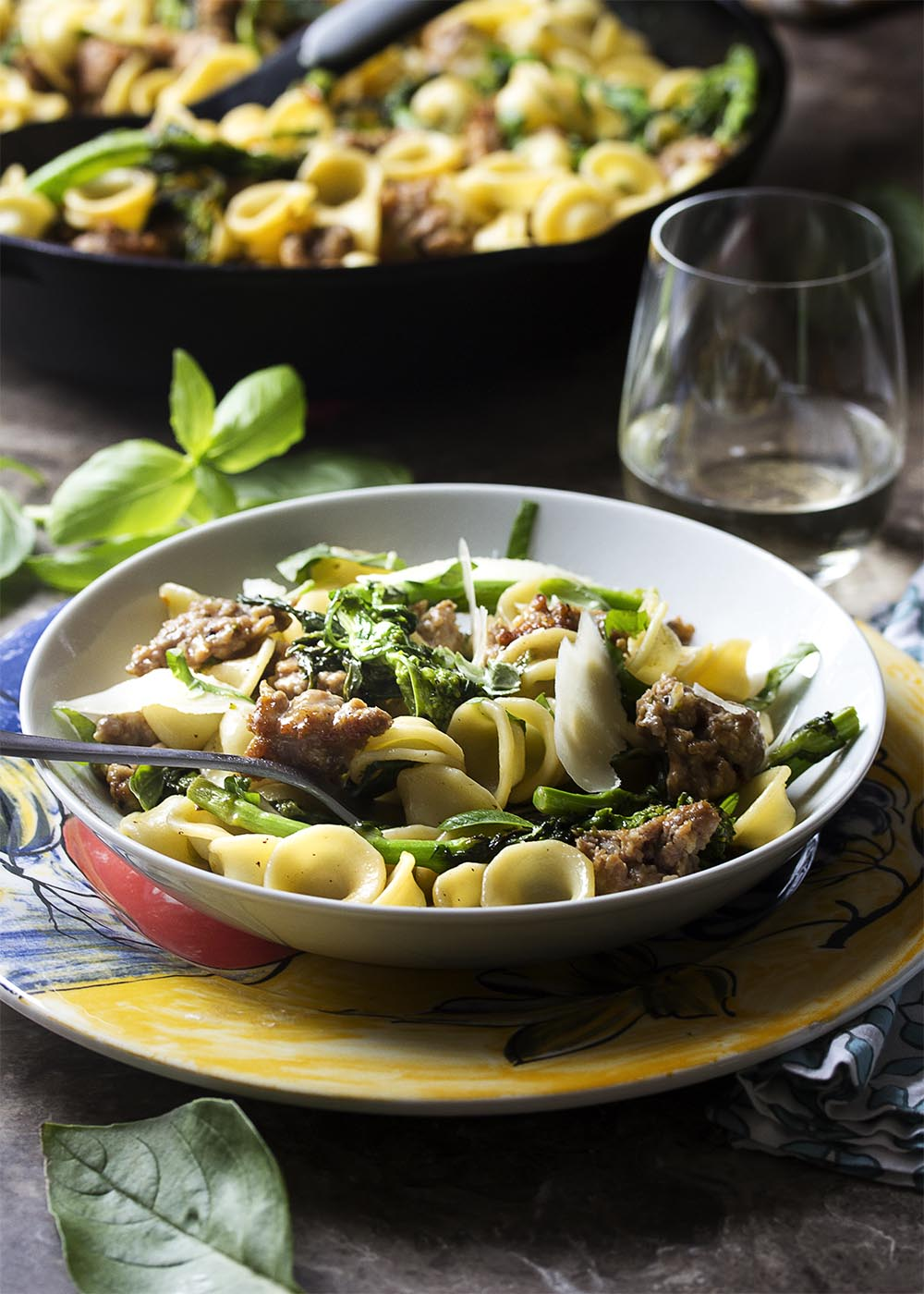For a healthy and easy weeknight dinner this Italian recipe for orecchiette pasta, broccoli rabe, and sausage delivers flavor and gets dinner on the table fast. | justalittlebitofbacon.com