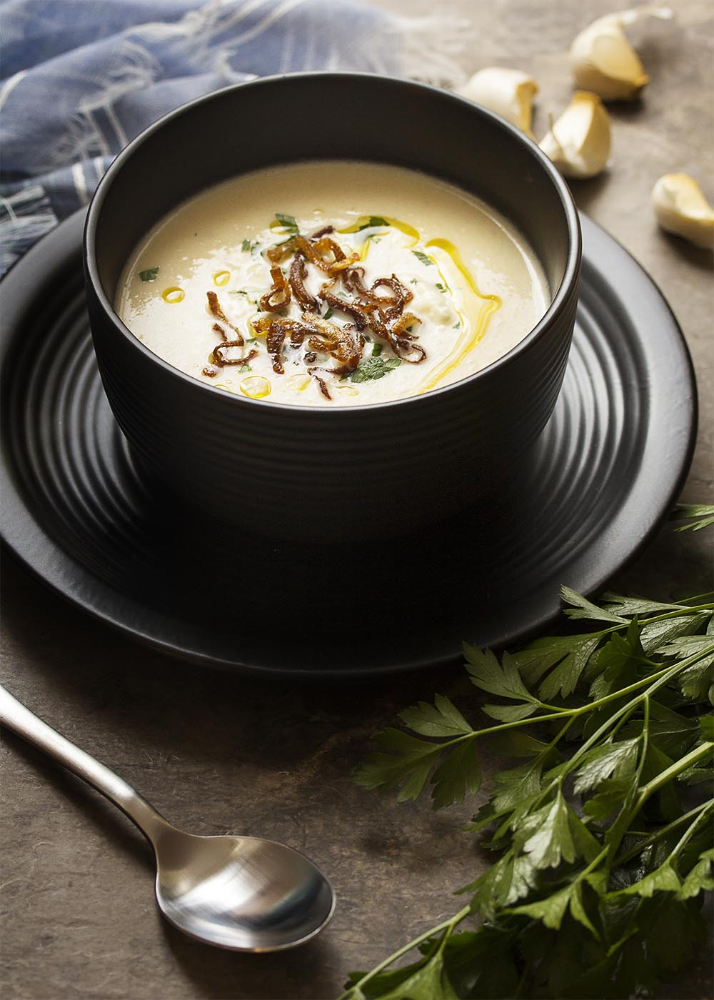 This smooth and creamy cauliflower soup is swirled with blue cheese and topped with truffle oil for great comfort food on a chilly day! | justalittlebitofbacon.com