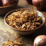 Making crispy fried shallots is a simple and easy process! All you need are three ingredients and a little time to get them golden brown. Gluten-free. Vegan. | justalittlebitofbacon.com