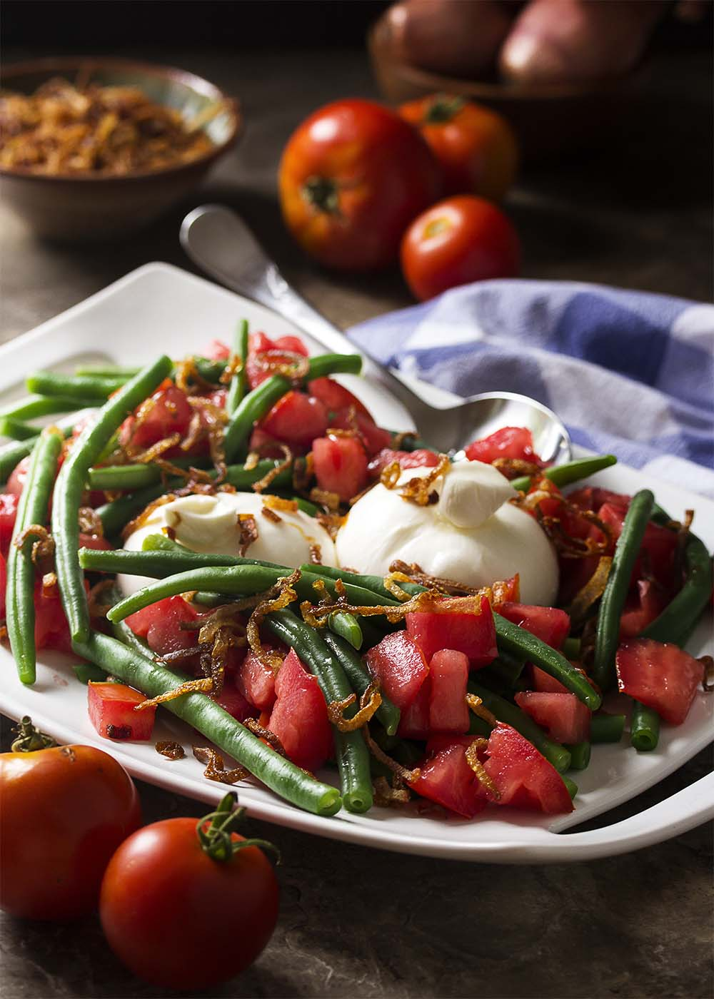 Creamy burrata, crispy shallots and ripe tomatoes along with fresh green beans give my Italian green bean salad plenty of flavor and balance. Add in a homemade Italian dressing and you'll want to make this salad every week! | justalittlebitofbacon.com