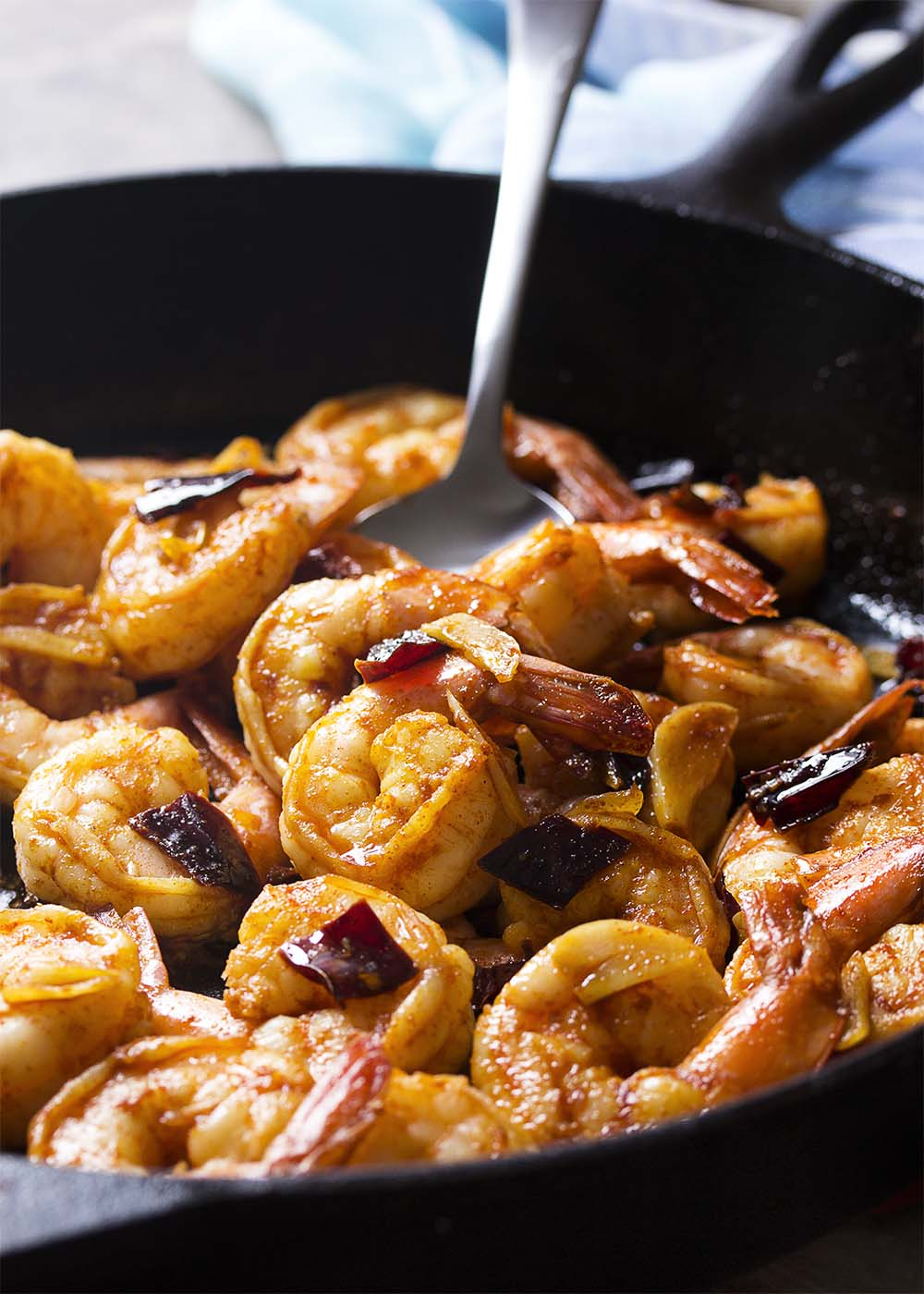 Plump and juicy shrimp, soft sliced garlic, and sweet and smoky paprika combine in this classic tapas recipe for Spanish garlic shrimp. Quick and easy! Make sure you have plenty of bread to soak up the flavorful olive oil! | justalittlebitofbacon.com