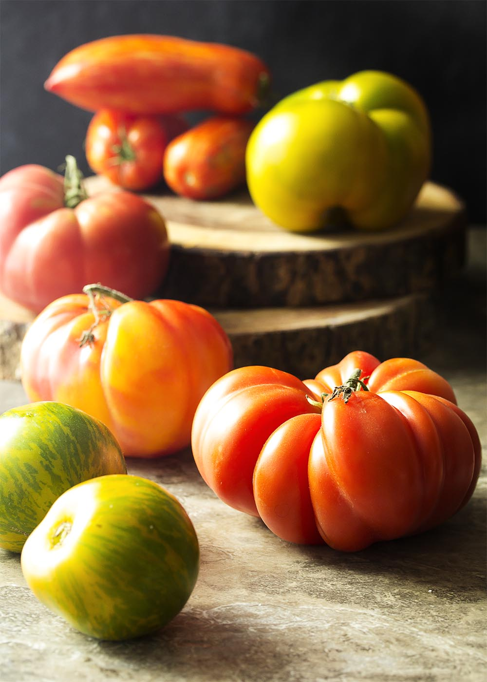 What are heirloom tomatoes? What are great recipes for heirloom tomatoes? Learn about their history, varieties, and more in this ingredient spotlight! | justalittlebitofbacon.com
