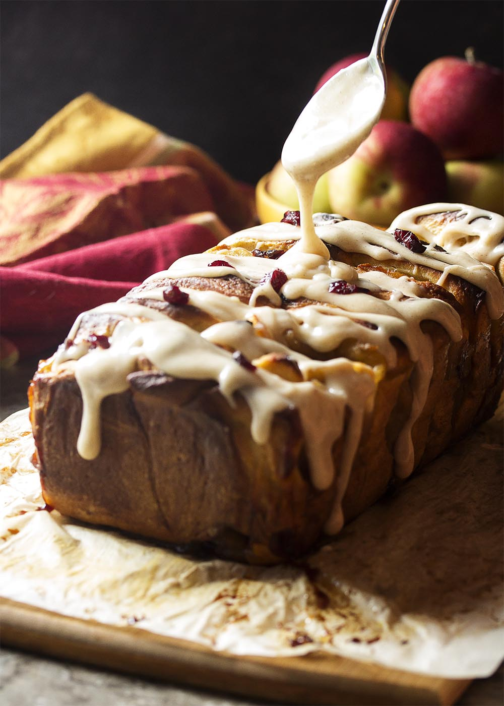 Apple pie filling and bourbon soaked cranberries are sandwiched in between layers of rich bread dough in this apple pull apart bread. | justalittlebitofbacon.com