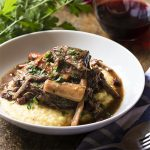 Beef braised in barolo is a delicious and comforting Italian stew cooked low and slow until the red wine has transformed into a rich sauce and the beef is falling apart. | justalittlebitofbacon.com