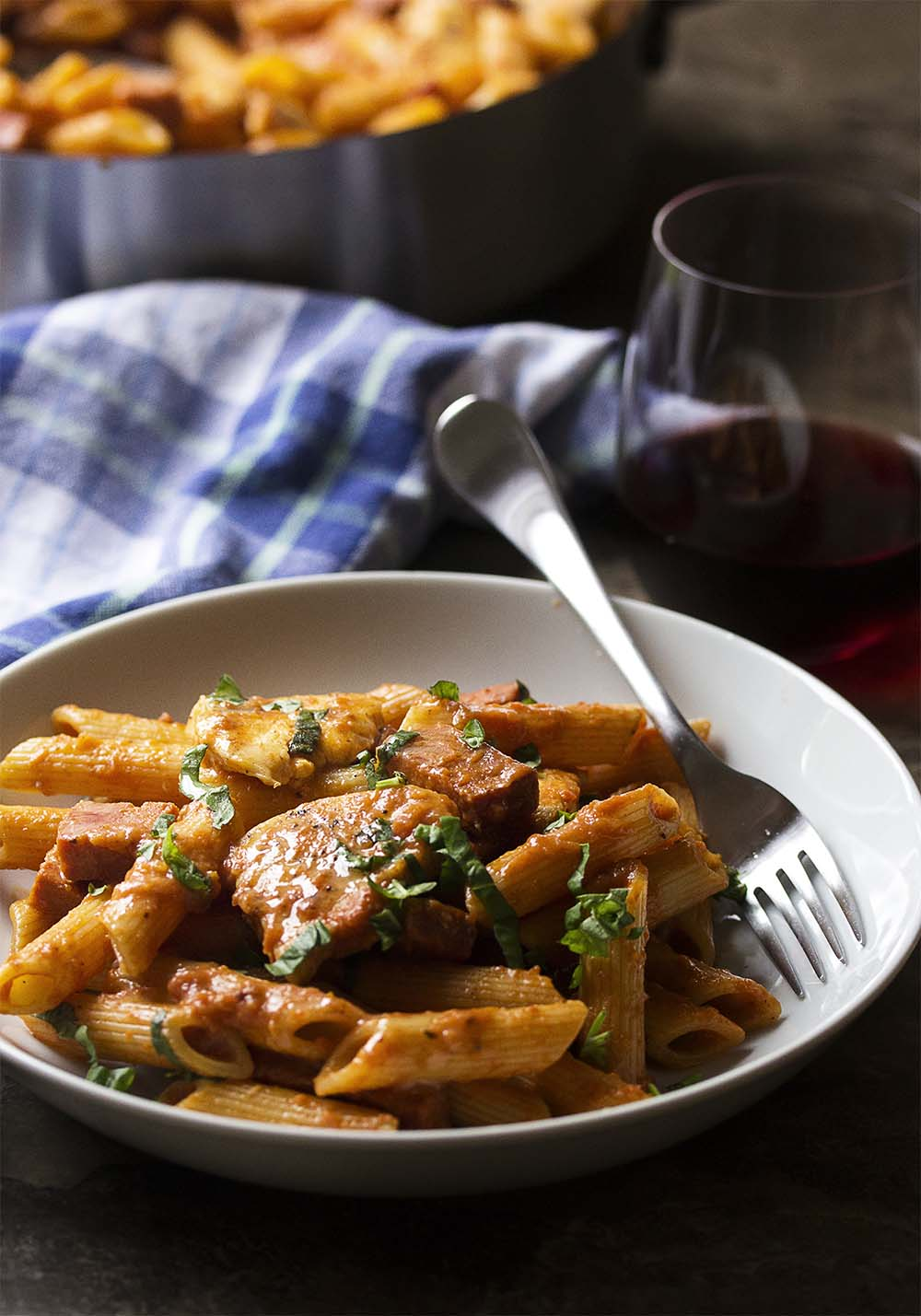 My penne alla vodka is creamy and full of deep tomato flavor from homemade marinara along with plenty of seared chicken and chorizo sausage. Easy weeknight meal! | justalittlebitofbacon.com