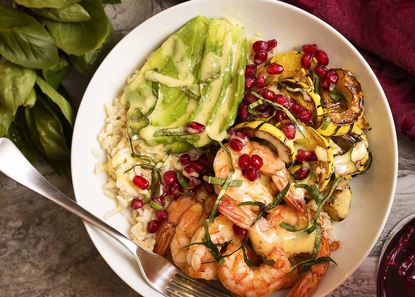 This shrimp rice bowl is full of healthy veggies like roasted delicata squash and avocado and topped with a creamy aioli for a cozy dinner. Gluten-free. | justalittlebitofbacon.com