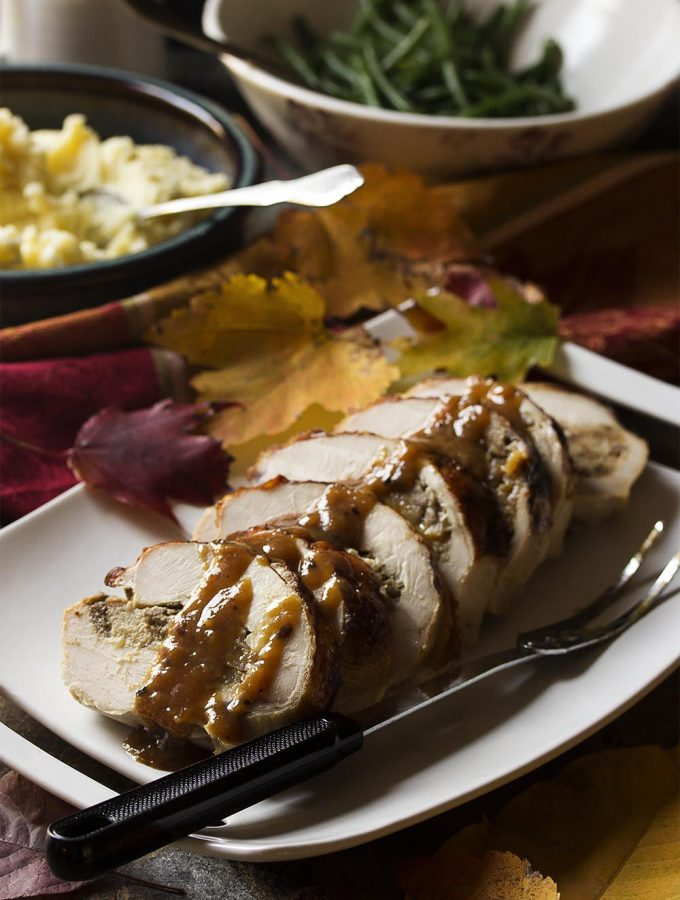 My fig and sausage stuffed turkey breast roulade makes an impressive main course which is perfect for Thanksgiving or Christmas holiday dinner. And while it rests you can make a white wine gravy from the drippings!
