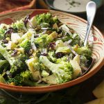 My creamy broccoli apple salad is full of flavor! It's tossed with a tangy buttermilk dressing and has a nice balance between sweet and savory. Great for summer bbqs or for the holiday table. | justalittlebitofbacon.com