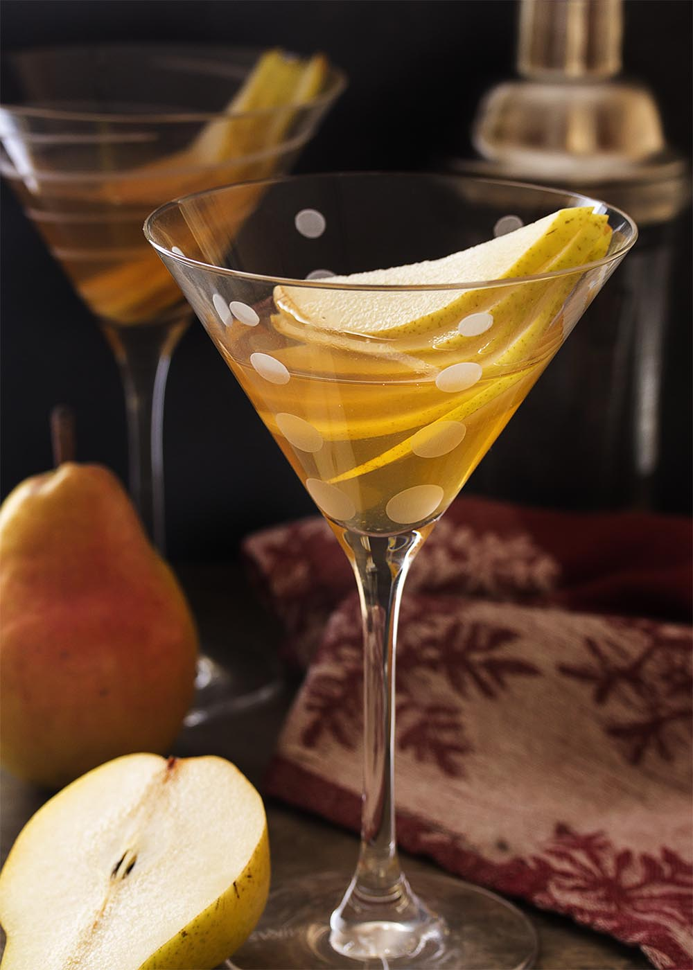 Have some ripe pears sitting on your counter? Make some spiced pear syrup and shake it with pear brandy and vodka for a double pear martini! | justalittlebitofbacon.com