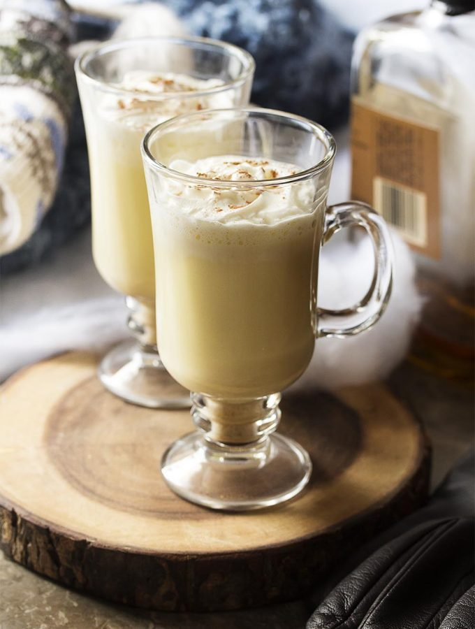 Homemade hot bourbon eggnog is easy to make and will warm you right through. I think it's the perfect drink for cold and snowy days by the fire! | justalittlebitofbacon.com