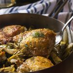Looking for a new chicken recipe? Love artichokes? My pan roasted chicken and artichokes with a white wine lemon pan sauce is a great skillet dinner full of Mediterranean flavors and a great way to use fresh, baby artichokes. | justalittlebitofbacon.com