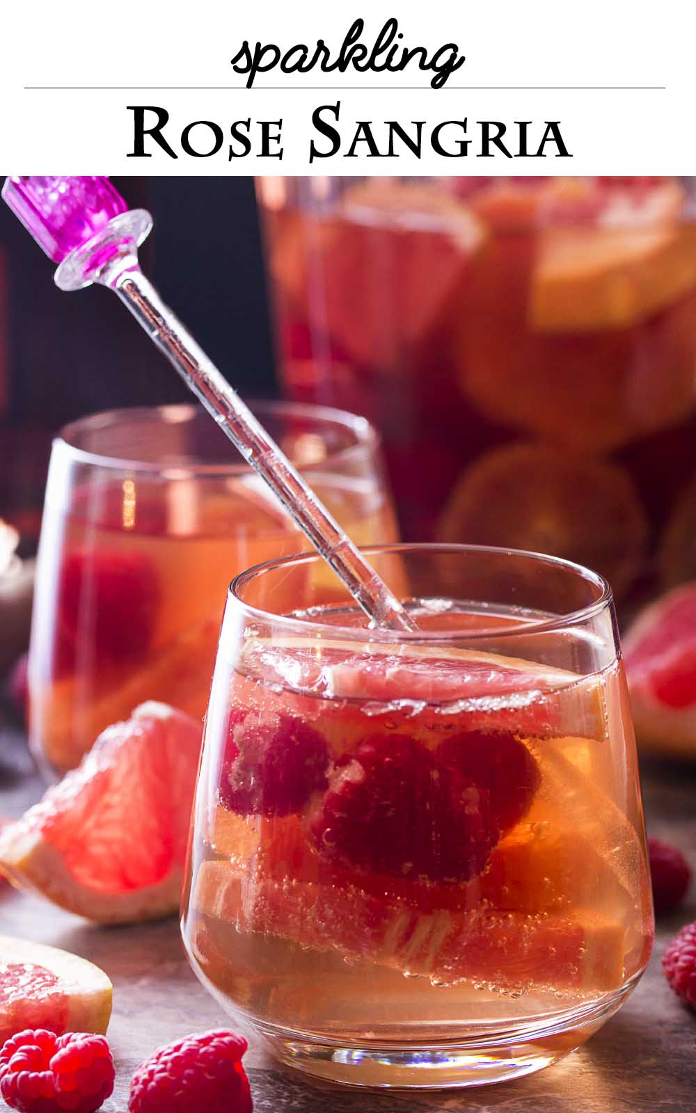 Sparkling rose sangria is made from rose still and sparkling wines, fortified with brandy and orange liqueur, then mixed with raspberries and winter citrus, like blood oranges and pink grapefruit. Great for romantic dinners, winter and spring parties, and valentine's day! | justalittlebitofbacon.com #cocktailrecipe #drinkrecipe #sangria #valentinesday #datenight #cocktails #drinks
