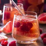 Sparkling rose sangria is made from rose still and sparkling wines, fortified with brandy and orange liqueur, then mixed with raspberries and winter citrus, like blood oranges and pink grapefruit. Great for romantic dinners, winter and spring parties, and valentine's day!