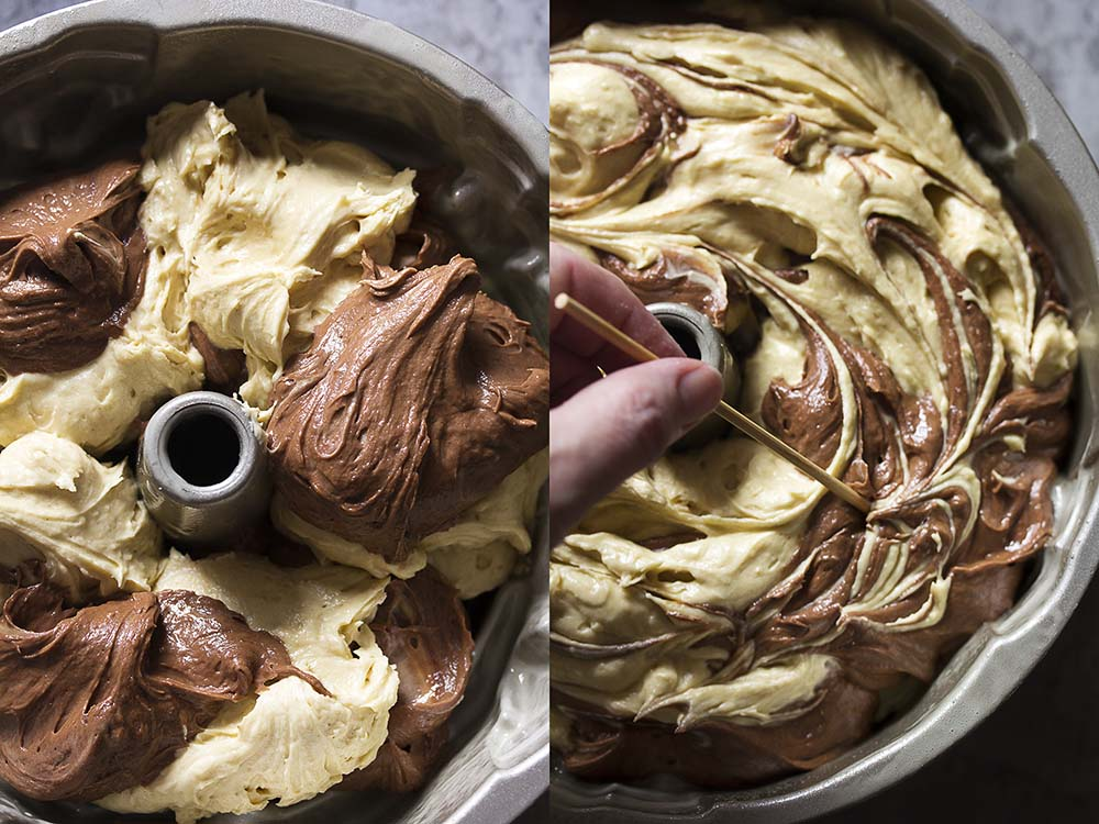 Two picture collage. Left is a top view of the bundt pan filled with dollops of yellow and chocolate batter. Right is the same view showing a long skewer mixing the batters.