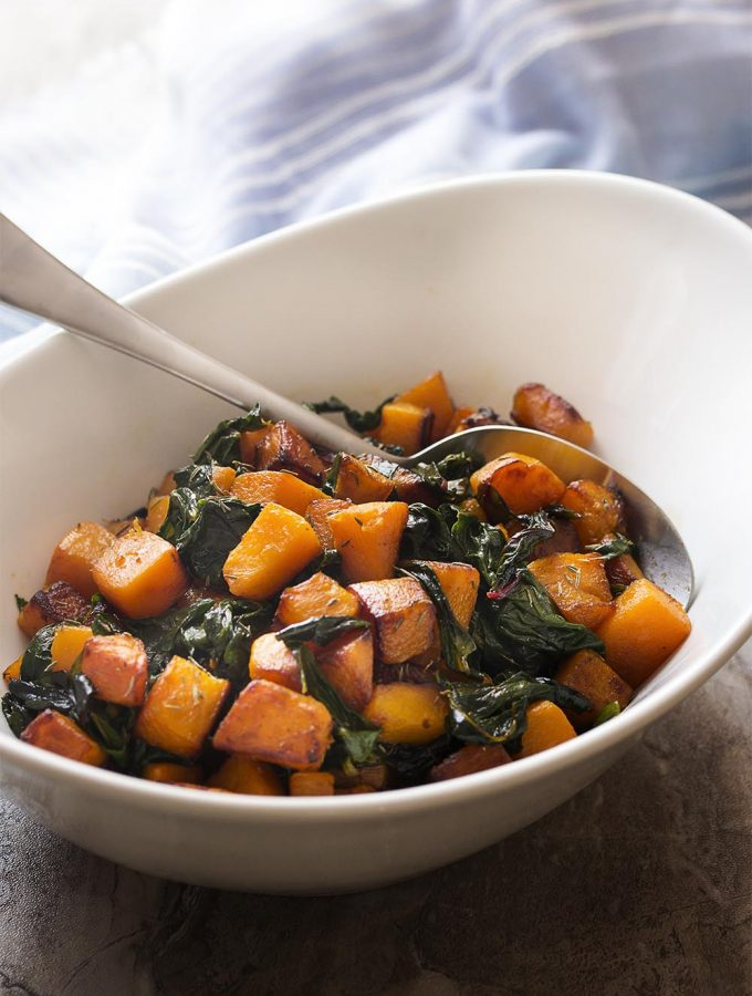 Looking for a great fall and winter side? My recipe for butternut squash and Swiss chard is quick, healthy, and full of caramelized cubes of winter squash and tender chopped chard. | justalittlebitofbacon.com #butternutsquash #sidedish #wintersquash #swisschard #healthyrecipes