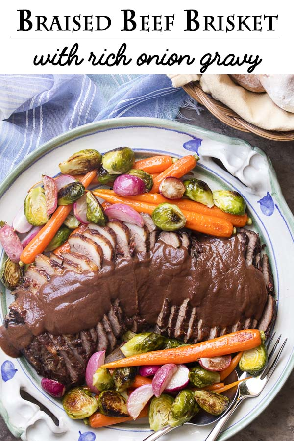 For a delicious and fork-tender oven braised beef brisket, cook it low and slow in red wine and onions. Then let it cool for easy slicing and puree the sauce for a thick and rich onion gravy. Great holiday roast! | justalittlebitofbacon.com #beefbrisket #passover #easter #holidayrecipes #roastbeef