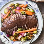 For a delicious and fork-tender oven braised beef brisket, cook it low and slow in red wine and onions. Then let it cool for easy slicing and puree the sauce for a thick and rich onion gravy.