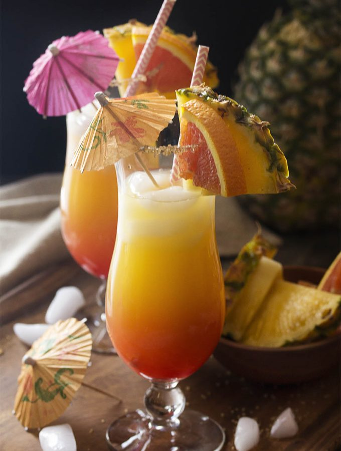 The tropical flavors of pineapple, orange, and coconut and the rosy, sunset color of this pineapple rum punch will take you right to a Caribbean beach. You can make it by glass or in a pitcher for a crowd!
