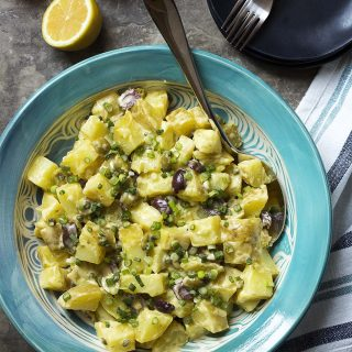 Looking for the best potato salad? Then you need to try my potato salad with olives and capers all tossed together with a homemade mayonnaise. Lemony, creamy, buttery, and tangy!
