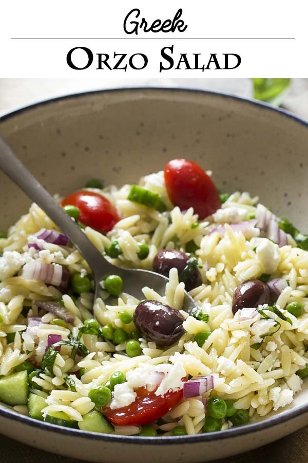 Greek orzo salad with peas, tomatoes, and feta is one of my favorite Mediterranean dishes to bring to potlucks, bbqs, and summer cookouts. It's a simple recipe, but always a hit. | justalittlebitofbacon.com #pasta #pastasalad #greekrecipes #greeksalad #orzo