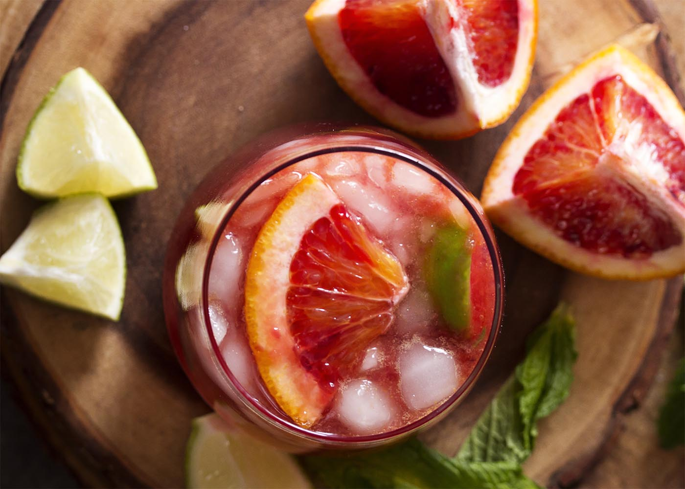 Top down view of a glass of moscow mule with blood orange slice arranged on top.