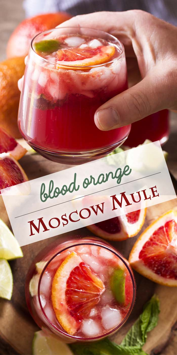 For a fun variation on the classic Moscow mule, try a blood orange Moscow mule! Ginger beer, lime, and vodka are mixed with blood orange juice and pomegranate in this tasty cocktail. | justalittlebitofbacon.com #cocktailrecipe #drinkrecipe #moscowmule #bloodoranges #cocktails #drinks
