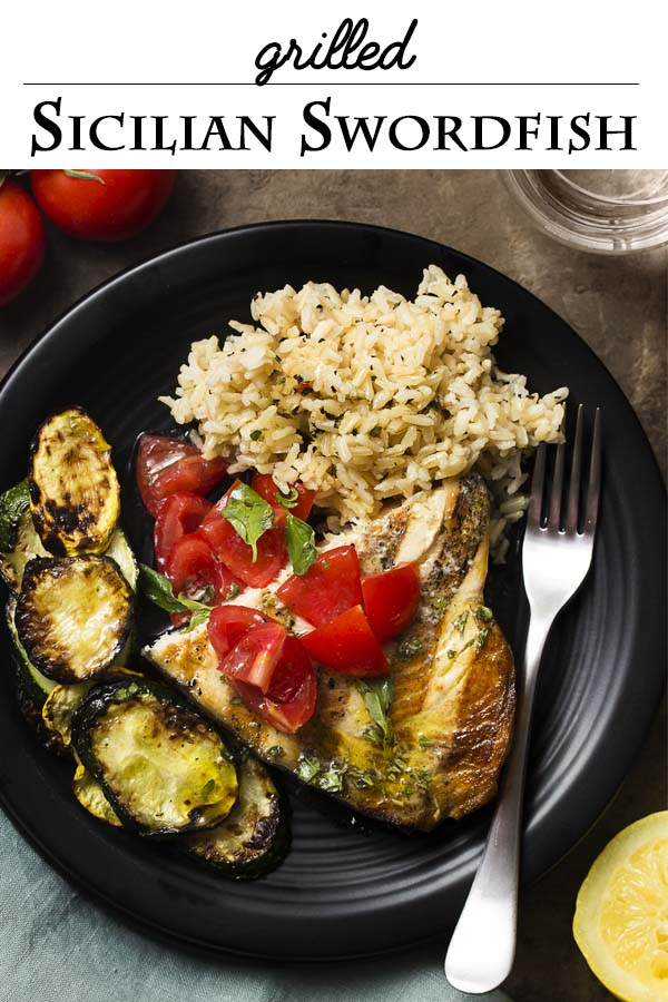 Sicilian swordfish is an easy dinner recipe perfect for a summer's evening. Just fire up the grill to cook your summer squash and then the swordfish steaks, top it all with a tangy lemon and olive oil oregano sauce and some diced tomatoes, and you have a meal! | justalittlebitofbacon.com #italianfood #dinnerrecipes #fishrecipes #swordfish #grilling