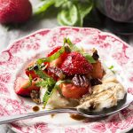 Dive into summer with this easy strawberry burrata salad! Fresh strawberries and creamy burrata are tossed with mint, basil, and pecans then topped with a honey balsamic glaze.