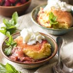 What do you get when you combine a custard pie and fruit cobbler? A strawberry rhubarb cobbler with custard filling! Delicious, creamy, and full of fruit.