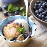 Fresh and easy, this homemade blueberry skillet cobbler is flavored with mint, cinnamon, and maple syrup and cooked right in your cast iron pan. Great for breakfast or dessert with a scoop of vanilla ice cream.