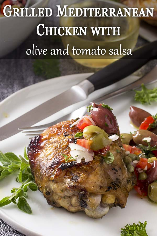 For a healthy summer dinner, try grilled Mediterranean chicken thighs, which are herb marinated then grilled and topped with a olive and tomato salsa. | justalittlebitofbacon.com #chickenrecipes #grilling #summerrecipes #mediterraneandiet #easydinners