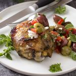 For a healthy summer dinner, try grilled Mediterranean chicken thighs, which are herb marinated then grilled and topped with a olive and tomato salsa.