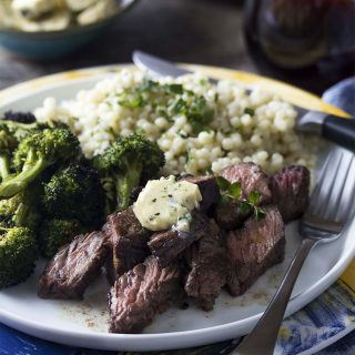 Juicy and packed full of beefy flavor, grilled sirloin tip steaks topped with an amazing herb and shallot compound butter are an easy weeknight dinner which won't heat up your house.