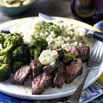 Juicy and packed full of beefy flavor, grilled sirloin tip steaks topped with an amazing herb and shallot compound are an easy weeknight dinner which won't heat up your house.