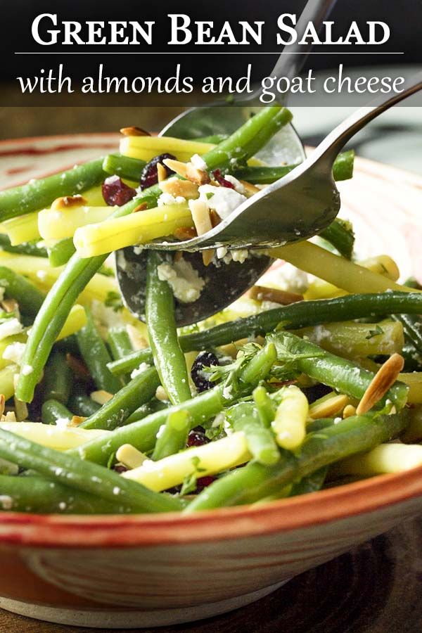 This fresh green bean almond salad with goat cheese and dried cranberries is tossed with a simple vinaigrette. It's the perfect salad for any night. Great for summer parties, weeknight dinners, holidays like Thanksgiving and Christmas. | justalittlebitofbacon.com #summerrecipes #holidayrecipes #saladrecipes #salads #greenbeansalad #greenbeans