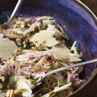 Kohlrabi apple slaw is a yummy salad made from sweet apples, spicy radishes, and peppery kohlrabi, all tossed with a simple oil and vinegar dressing.