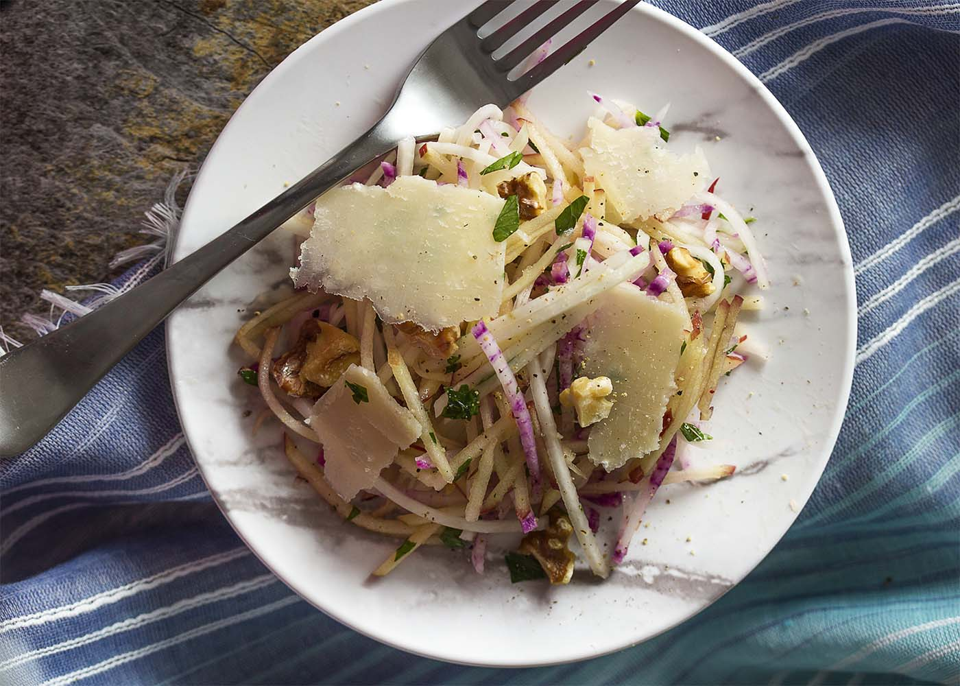 Top down picture of a small plate of kohlrabi slaw.