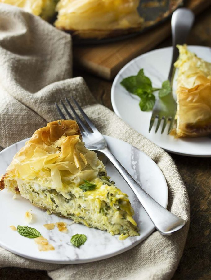 Kolokithopita is a seasonal Greek pie full of zucchini and summer squash mixed with herbs, feta cheese, and eggs. All wrapped in a golden brown fillo crust.